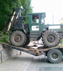 Tractor op laadbruggen